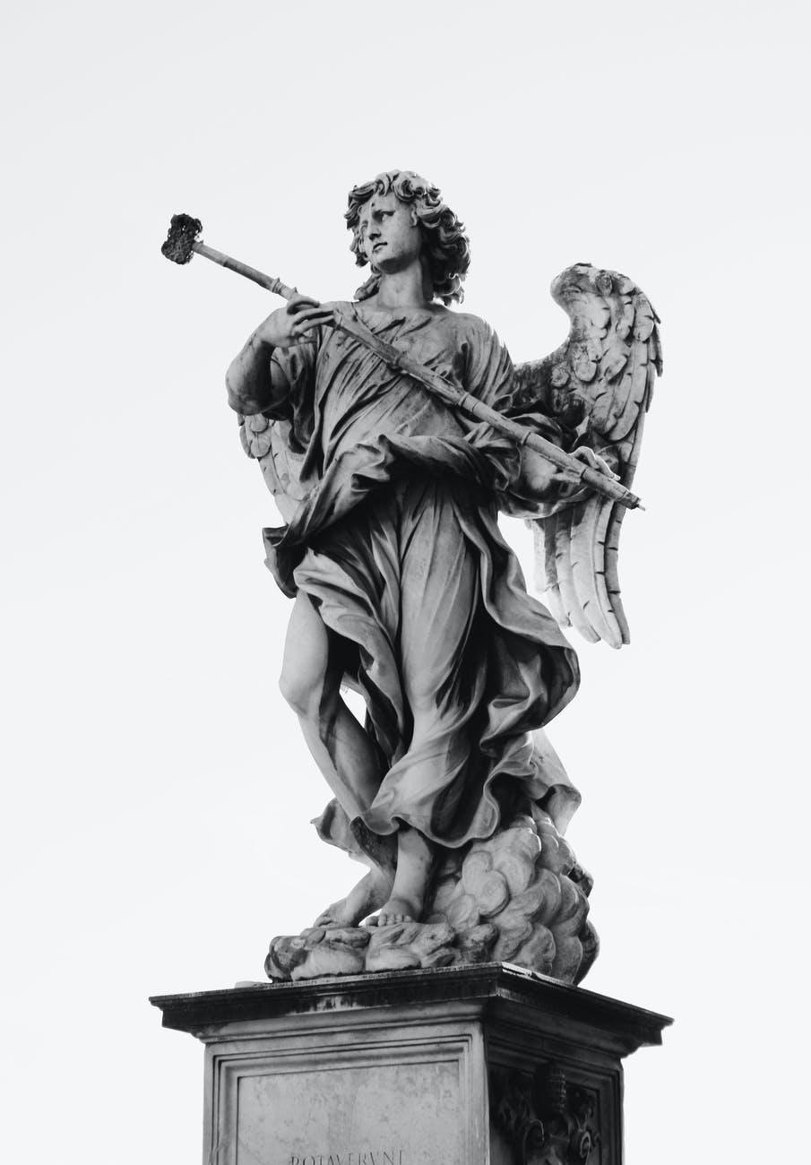 black and gray angel statue decor