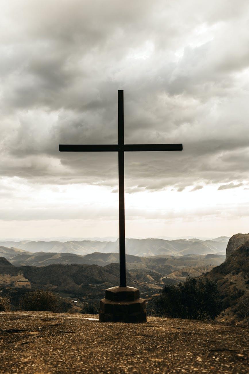 black cross on top of mountain